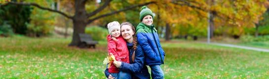 Family at autumn park Stock Photos