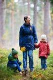 Family at autumn park Royalty Free Stock Photos