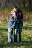 Family in autumn park. Royalty Free Stock Photography