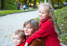 Family in autumn park Stock Image