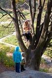 Family in autumn park Royalty Free Stock Photo