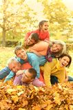 Family in autumn park Royalty Free Stock Photos