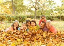 Family in autumn park Stock Photo