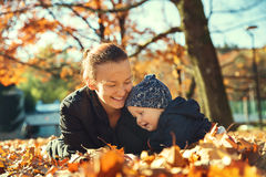 Family in the autumn park. Royalty Free Stock Photo