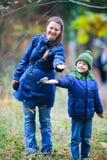 Family at autumn park Stock Photography