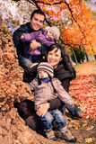 Family in the autumn park Stock Photos