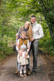 Family in the autumn park Royalty Free Stock Image