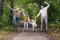 Family in the autumn park Stock Photography