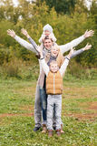 Family in the autumn park Royalty Free Stock Photography