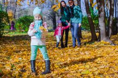 Family in autumn park on a sunny warm day Stock Image