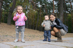 Family on autumn walk Royalty Free Stock Photo