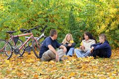 Family - Autumn Walk. A family resting in the leaves