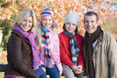 Family on autumn walk. Sitting on fence Stock Images
