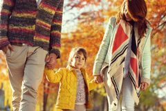 Family autumn walk in nature royalty free stock photography