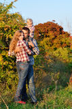 Family in the autumn wood Royalty Free Stock Image