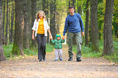 Family in autumnal wood. Stock Images