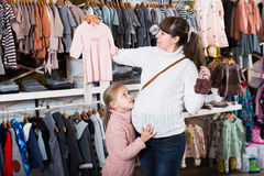 Family in baby's cloths shop Royalty Free Stock Photography