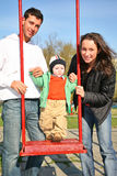 Family with baby. On seesaw stock image
