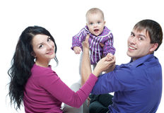 Family with a baby Stock Photos