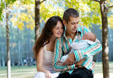 Family with baby in autumn park Royalty Free Stock Photography