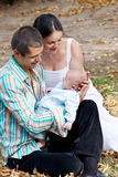 Family with baby in autumn park Stock Image