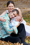 Family with baby in autumn park Stock Images