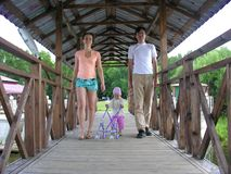 Family with baby on bridge. Family with baby walk on bridge Royalty Free Stock Photography