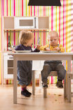Family baby brother and sister play eat meal in toy kitchen Royalty Free Stock Images