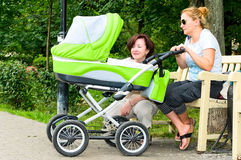 Family with baby carriage Stock Photos