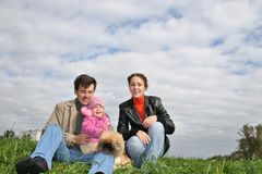 Family with baby and dog Stock Images