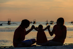 Family with baby enjoying time together at sunset Royalty Free Stock Image