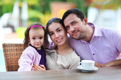 Family with baby girl in the cafe Stock Images