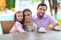 Family with baby girl in the cafe Stock Image