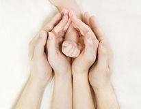 Family Baby hands, Newborn Kid hand into Mother Father Parents hands stock image