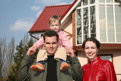 Family with baby and house stock images
