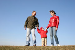 Family with baby on meadow Royalty Free Stock Photography