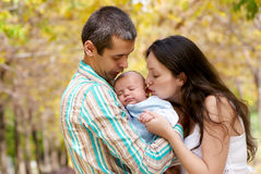 Family with baby in park Royalty Free Stock Image