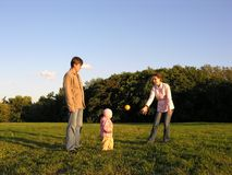 Family with baby play. On meadow Royalty Free Stock Photos