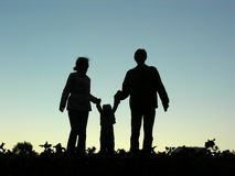 Family with baby silhouette Stock Photography