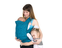 Family, baby in a sling royalty free stock photo