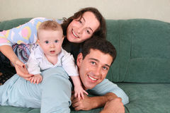 Family with baby on sofa Royalty Free Stock Photography