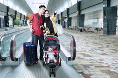 Family with baby standing in the airport hall Royalty Free Stock Image
