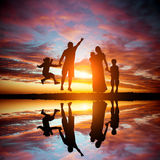 Family on a background of the magnificent sunset Royalty Free Stock Photo