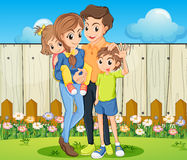 A family at the backyard with a wooden fence Stock Photography