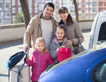 Family with baggage at parking lot Royalty Free Stock Photo