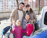 Family with baggage at parking Stock Photography