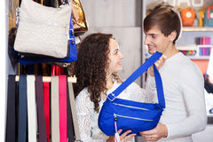 Family in the bags shop. Positive smiling family in the bags shop stock photography