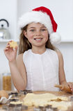 Family baking Christmas cakes in the kitchen royalty free stock image