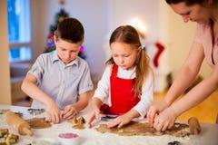 Family baking Christmas cookies Royalty Free Stock Photos