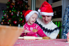Family baking Christmas cookies at home kitchen Stock Images